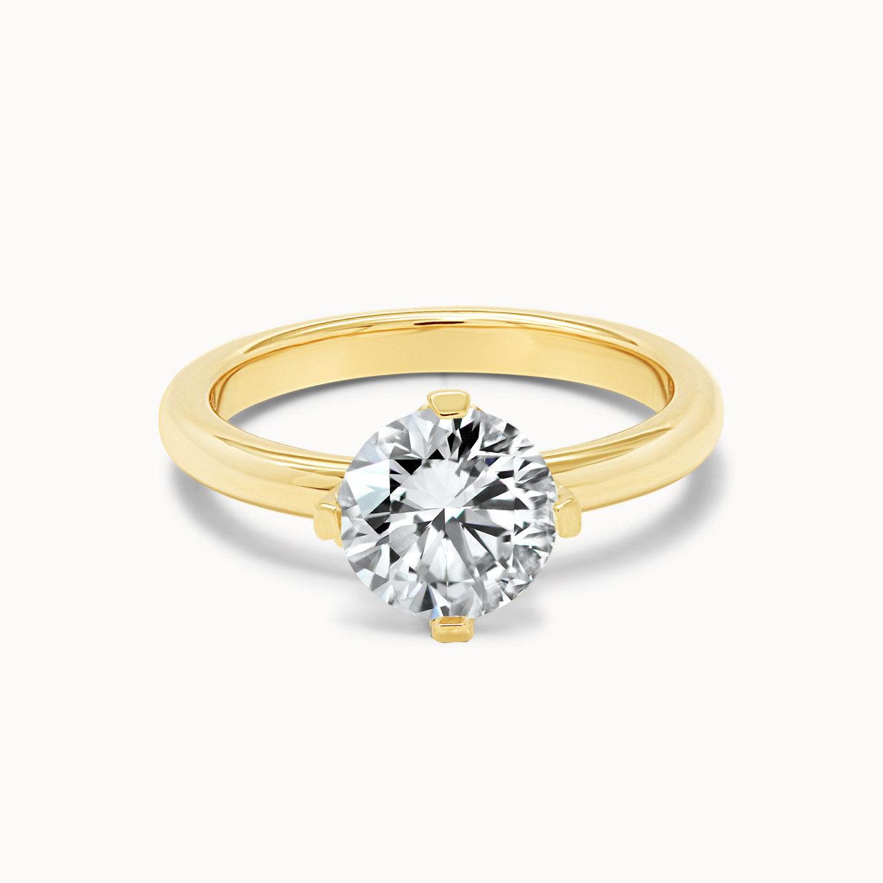 Goldener Verlobungsring mit 4 Krappen aus Gold und 1,25